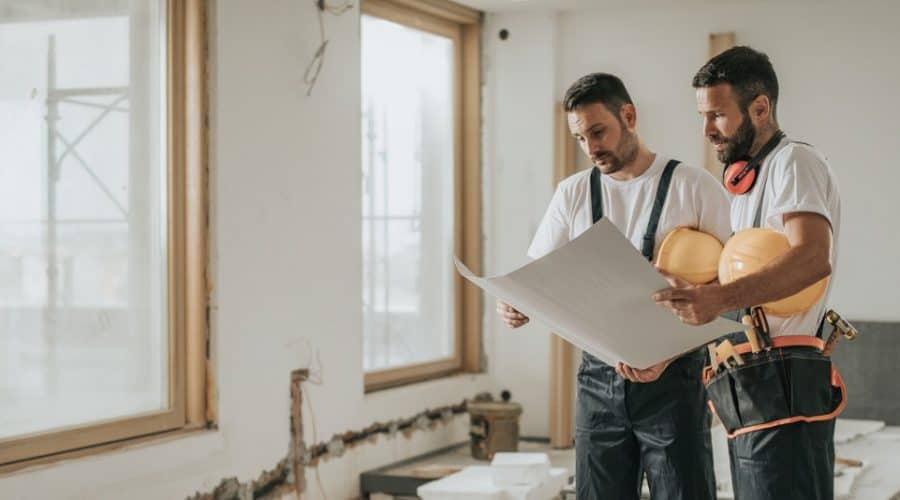Home renovation contractor reviewing plans